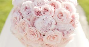 A unique domed hand tied bouquet of light pink sweet avalanche roses, small pink...